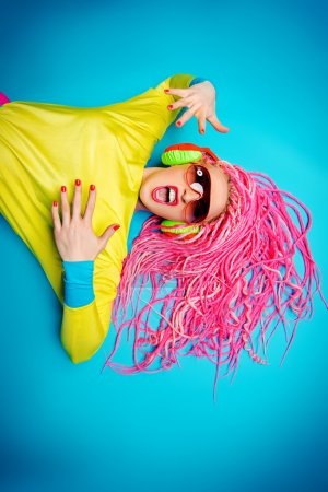 Photo for Crazy expressive trendy DJ girl in bright clothes, headphones and bright dreadlocks. Disco, party. Bright fashion. - Royalty Free Image