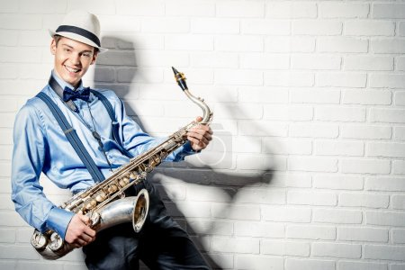 Photo for Young expressive musician playing the saxophone. Art and music. Jazz music. - Royalty Free Image