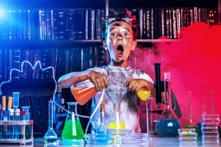 Photo for A boy doing experiments in the laboratory. Explosion in the laboratory. Science and education. - Royalty Free Image