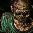 Close-up portrait of a horrible scary zombie man. ...