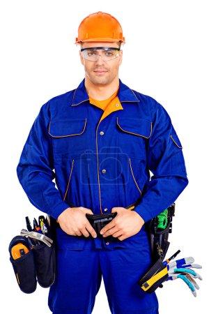 Photo pour Un ouvrier industriel portant uniforme et outils. Travail, profession. Isolé sur blanc . - image libre de droit