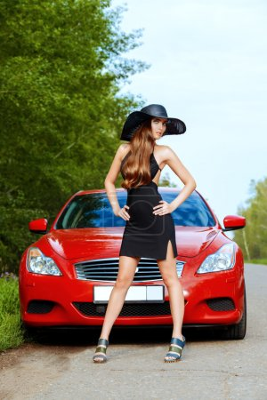 Photo for Attractive young woman near the red sports car. Beauty, fashion. Luxurious life. - Royalty Free Image