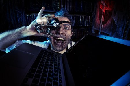 Photo for Old scientist working in his laboratory. Mixing eras. Halloween. - Royalty Free Image