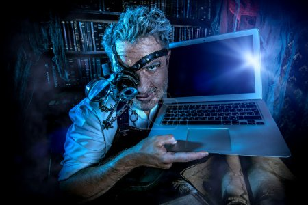 Photo for Old scientist working in his laboratory. Mixing eras. - Royalty Free Image
