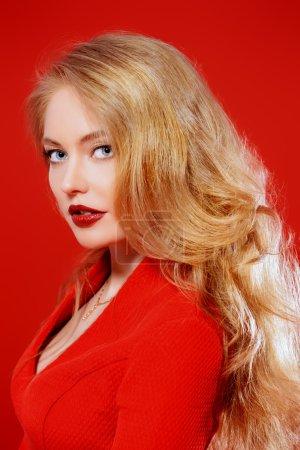 Blonde curled hair.