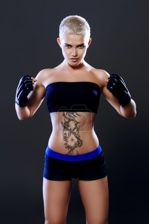 Athlete woman bodybuilder with a perfect athletic physique