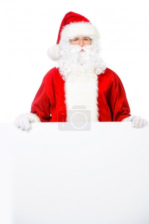 Santa Claus holding white billboard.