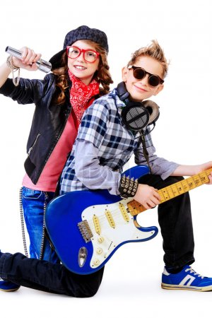 Modern teenagers playing electric guitar