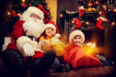 Photo for Santa Claus brought gifts for children. Christmas scene. - Royalty Free Image