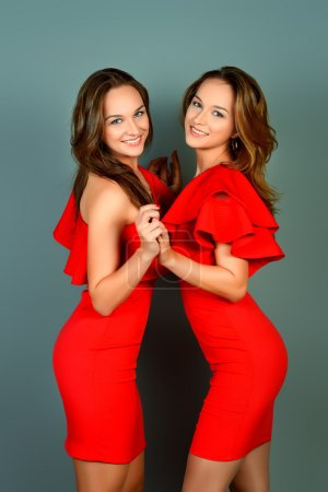 sisters in red