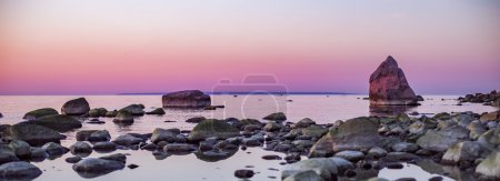 Panorama of a beautiful sunset over a rocky coastline
