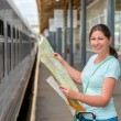 Woman traveling alone keeps the card at the statio...