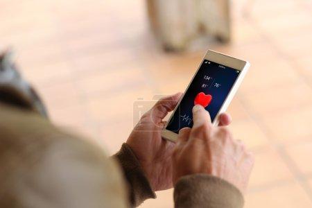 man touching screen of smartphone