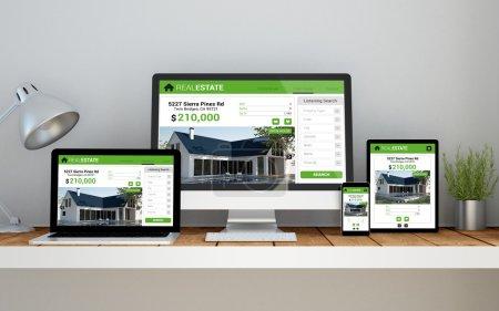 Photo pour Un ordinateur, ordinateur portable, smartphone et tablette sur un espace de travail de bureau avec biens immobiliers en ligne site sensible sur les écrans des appareils - image libre de droit