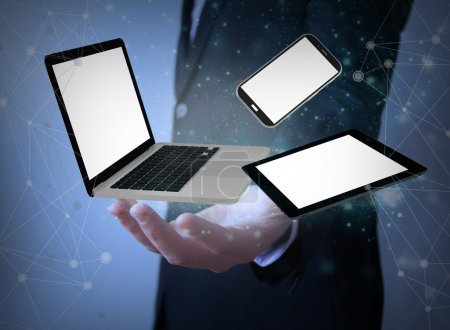 Photo for Responsive devices over businessman hand with blank screens - Royalty Free Image