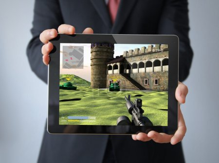 Photo for Businessman with videogame tablet - Royalty Free Image