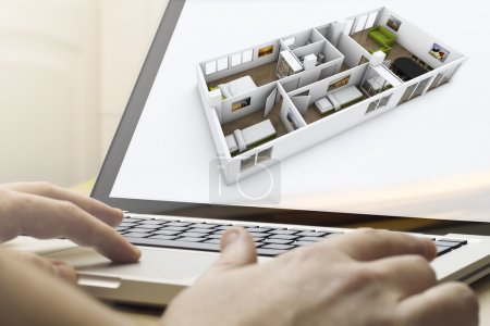Photo for Home renovation concept: man using a laptop to plan a house renovation - Royalty Free Image