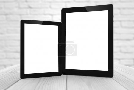 two tablets with different sizes and blank screen