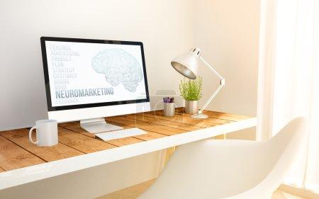 minimalist workplace with neuromarketing computer