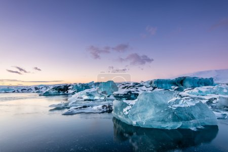 Crystal icebergs on   black beach in south Iceland...