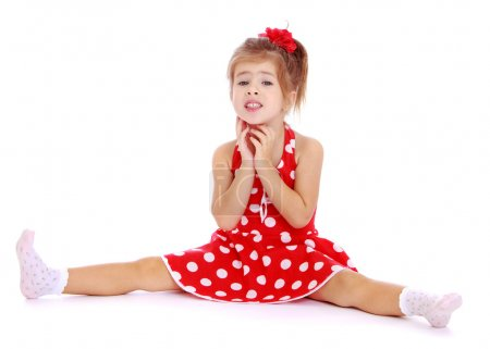 Beautiful little girl sitting legs spread wide.