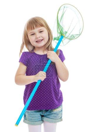 Beautiful blonde little girl holding a butterfly net for catchin
