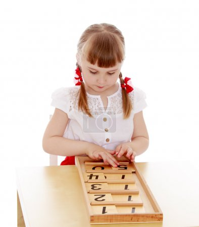 The girl is too young to attend school at the Montessori kinderg