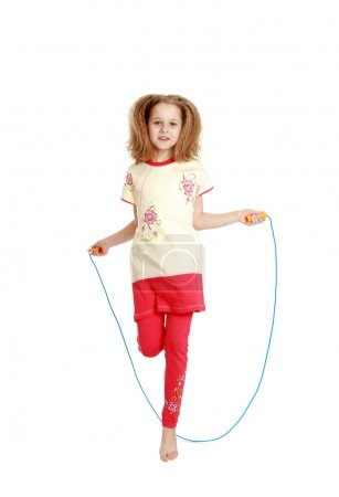 Cheerful girl jumping rope