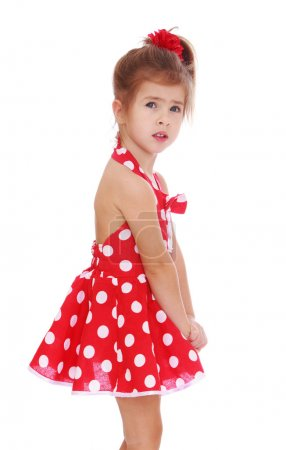 Beautiful little girl in a short red dress