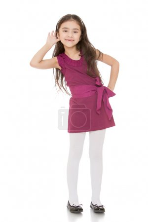 Fashionable little girl with long dark hair