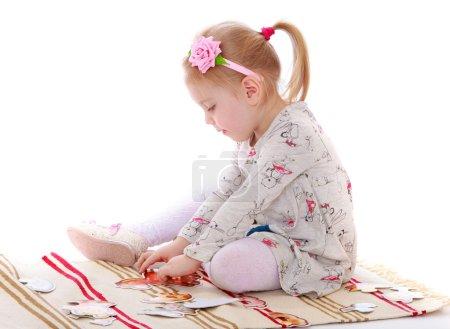 The girl in Montessori kindergarten
