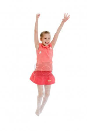 Photo for Cute little girl in a short red skirt with a pink shirt jumps.-Isolated on white background - Royalty Free Image