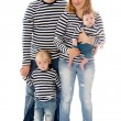 Studio photo of a family of 4 , father, mother, el...