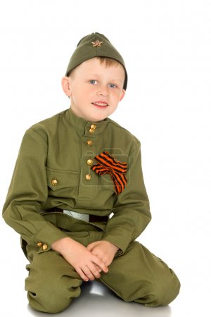boy in soldiers clothes
