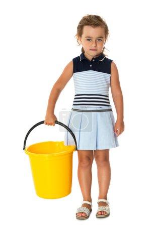 Little girl tidying