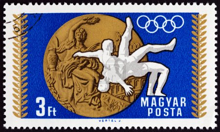 """HUNGARY - CIRCA 1969: A stamp printed in Hungary from the """"Medal Wins of the Hungarian Olympic Team, Mexico City """" issue shows Wrestling, circa 1969."""