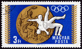 HUNGARY - CIRCA 1969: A stamp printed in Hungary from the Medal Wins of the Hungarian Olympic Team, Mexico City  issue shows Wrestling, circa 1969.
