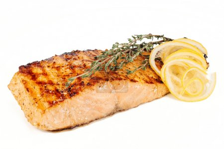 Photo for Salmon steak with lemon and rosemary on white background - Royalty Free Image