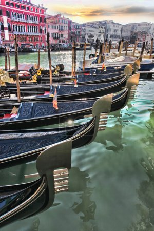 Venice with gondolas on canal in Italy