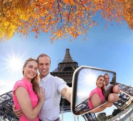 Couple Taking Selfie by Eiffel Tower in Paris, France