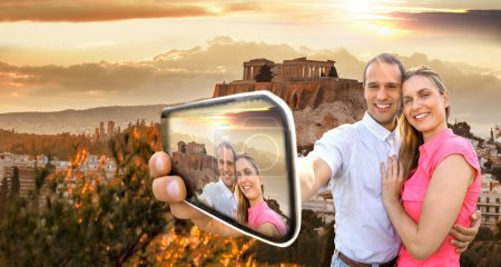 Photo for Couple taking selfie against Parthenon temple on Acropolis in Athens, Greece - Royalty Free Image