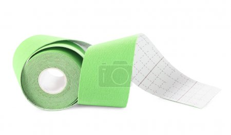 Green kinesio tape in roll on white background...