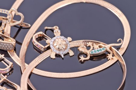 Gold pendants in the form of turtles and salamanders