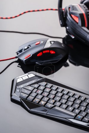 Gaming keyboard and mouse on shiny surface