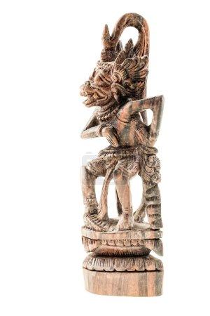 Photo pour Une statuette orientale hindoue en bois isolée sur un fond blanc - image libre de droit