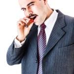Постер, плакат: man smoking cigar
