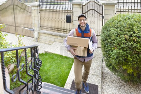 Photo for Courier Delivering a Package up on the stairs - Royalty Free Image