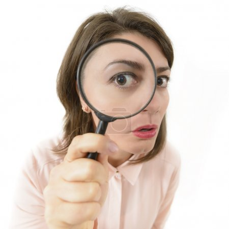 Photo for Price Cut Hunting, woman looking through an eyeglass - Royalty Free Image