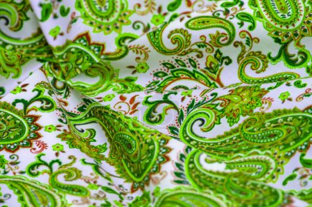 Photo for Paisley green pattern on a white background. Although the pinecone or almond shape is of Persian origin, the English name for the paintings comes from the town of Paisley in the west of Scotland. - Royalty Free Image