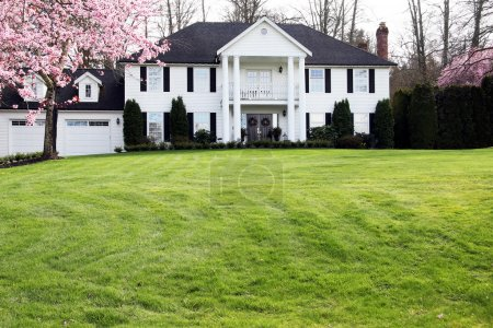 Elegant mansion with a large front lawn